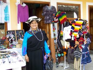 saraguro woman with handmade goods